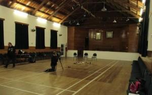Ian sets up cameras inside the hall.