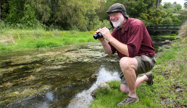 Natural history specialist and author Lloyd Esler hunts for otters on the banks of the Waihopai River